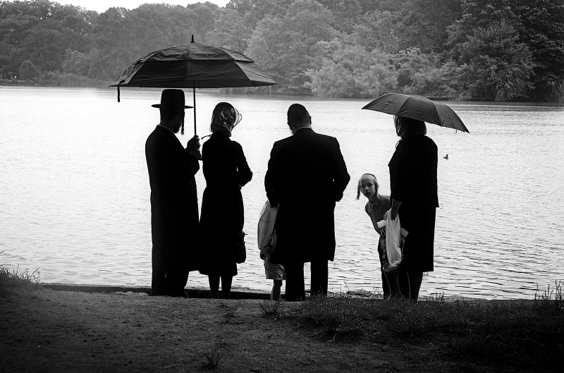 Jewish family enjoying the rainy day